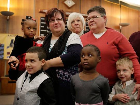Michigan plaintiffs April DeBoer and Jayne Rowse with their four children and DeBoer's parents.