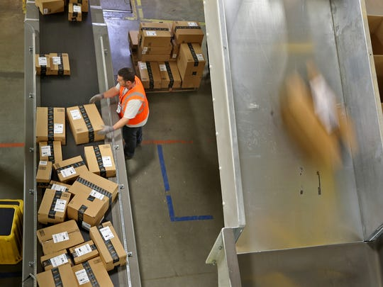 Amazon has hired thousands of workers in the Indianapolis area, including at its Whitestown fulfillment center, shown in a 2014 file photo.