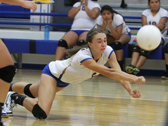 Bloomfield's Mattie Waresback digs for the ball during a game against Navajo Prep on Thursday at Bobcat Gym in Bloomfield.