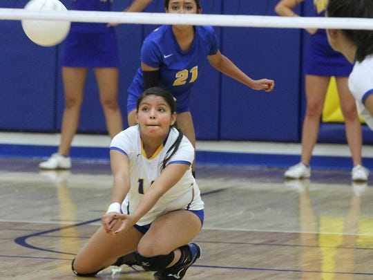 Bloomfield's Cheyenne Lopez digs for the ball during a game against Bernalillo on Thursday at Bobcat Gym in Bloomfield.
