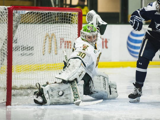 Vermont goalie Madison Litchfield (30) makes a save during the women's hockey game between the Yale Bulldogs and the Vermont Catamounts at Gutterson Field House on Saturday December 31, 2016 in Burlington. (BRIAN JENKINS/for the FREE PRESS)