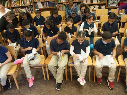 Third-grade students take a close look at their free dictionaries at the Memorial Family School in Camden. Camden City Rotary delivered 1,500 dictionaries to Camden City third graders. It's a yearly Rotary tradition, paid for through fundraisers.