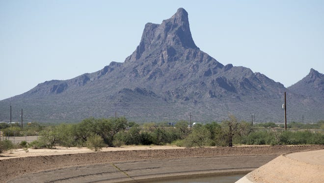 Picacho Peak, located 40 miles north of Tucson, rises beyond the CAP Canal, which channels Colorado River water used by Arizona cities. The Central Arizona Project (CAP) Canal, October 1, 2014, near Picacho Peak.