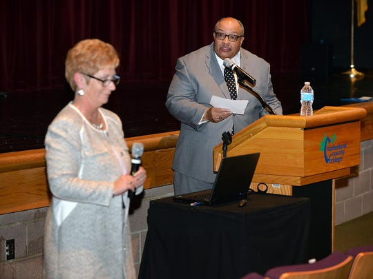 Dr. Keith Figgs, co chair of Cumberland County College's presidential search committee (right), poses a submitted question to position candidate Dr. Jacqueline Galbiati (left) during an open forum Monday, Feb. 22 in Vineland.