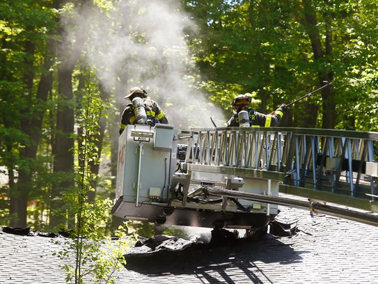 Firefighters respond to a 3-alarm fire at 18 Deer Run