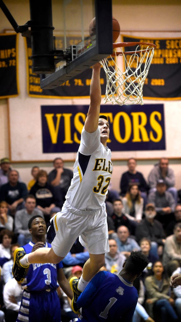 Raider guard Colton Lawrence sails over the defense in an attempted dunk in the first period. While the dunk wasn't successful, Elco was defeating Steel-High 80-58 at home Tuesday night, Feb, 16.