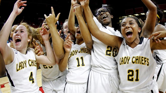 Piscataway's Kelsey Nugent #4, Taylor Nelson #11, Alliera McCoy #20 and Deonna Henry #21 celebrate their victory after defeating Monroe 77-74 in overtime to win the girls basketball GMC Tournament Final in Piscataway, N.J. on Thursday, February 26, 2015. Photo by Rich Schultz/ Home News Tribune