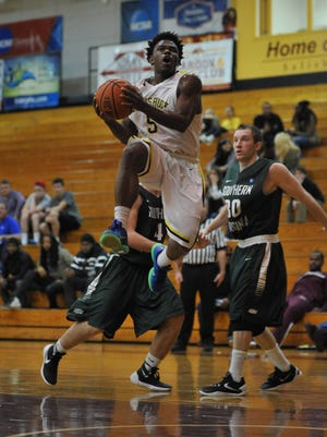 Adrien Straughn floats through the paint before lofting up a lay-up against Southern Virginia.