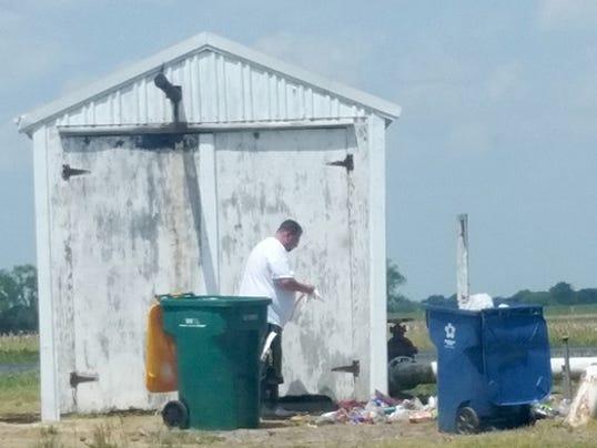 636619153784681612-05-11-2018-Michael-B-Warncke-ECU-ordered-trash-cleanup.jpg