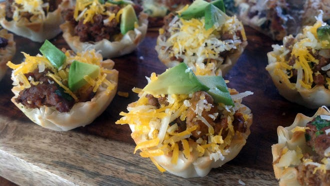 Taco Bites are easily prepared with premade miniature phyllo shells.