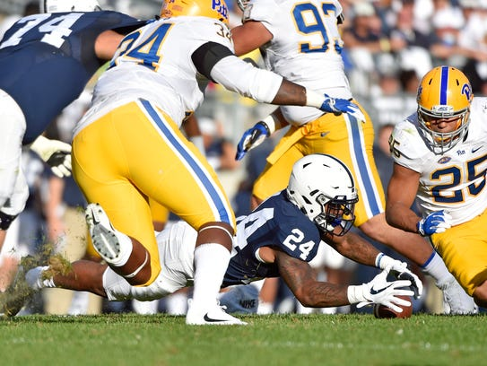 Penn State's Miles Sanders (24) recovers his fumble