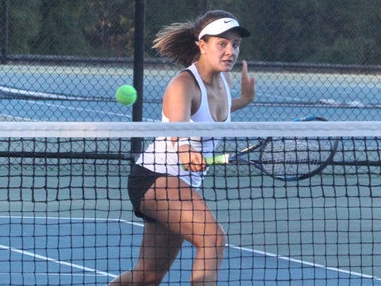 Ursuline's Laina Campos plays a shot at the net during a doubles match with Mamaroneck at the Section 1 girls tennis finals at Harrison Oct. 20, 2017.