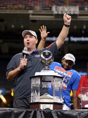 Dec 19, 2015; New Orleans, LA, USA; Louisiana Tech Bulldogs head coach Skip Holtz (left) celebrates with running back Kenneth Dixon (right) after winning the 2015 New Orleans Bowl against the Arkansas State Red Wolves at the Mercedes-Benz Superdome. Louisiana Tech won, 47-28. Mandatory Credit: Chuck Cook-USA TODAY Sports