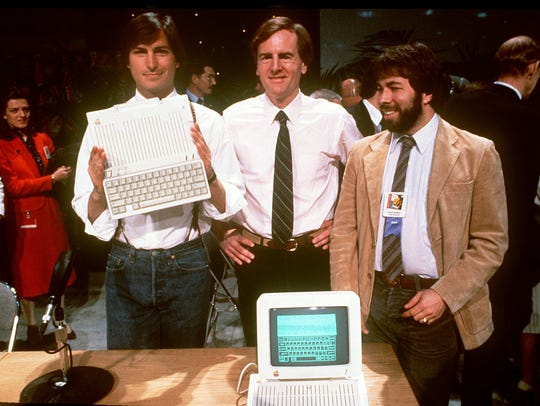 The late Steve Jobs, left, John Sculley and Steve Wozniak