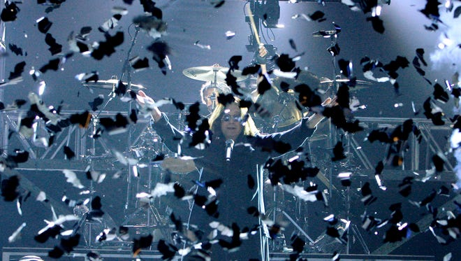 """""""Batman"""" Ozzy Osbourne performs in a cloud of fake bats during the VH1 Rock Honors concert in 2007."""