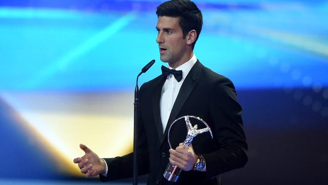 Novak Djokovic accepts his Laureus World Sportsman of the Year trophy during the 2016 Laureus World Sports Awards at the Messe Berlin  on April 18, 2016.