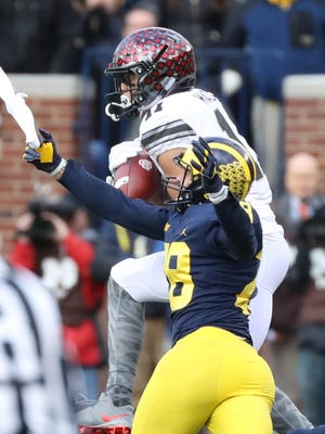 Michigan's Brandon Watson gives up a first-down catch to Ohio State's Austin Mack on Saturday, Nov. 25, 2017 at Michigan Stadium.