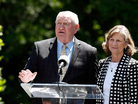 Agriculture Secretary Sonny Perdue, left, with his wife, Mary, speaks about a beehive placed at the vice president's residence, Tuesday, June 6, 2017, in Washington, D.C.