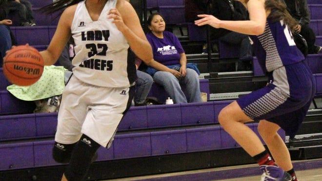 Mescalero's Katelyn Yuzos, left, dribbles past a Gateway Christian defender Monday night.