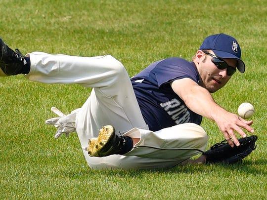 Richmond's Scott Ruegemer dives for a ball deep in