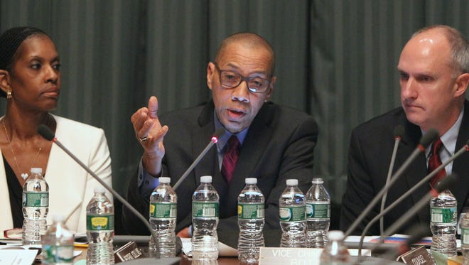 East Ramapo School District monitors Monica George-Fields, Dennis Walcott  and John Sipple present their report to the Board of Regents in Albany Dec. 14, 2015.