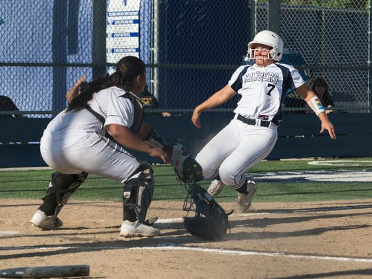Redwood's Sydnee Weber slides home in a game against Golden West in a West Yosemite League softball game on Thursday, May 3, 2018.