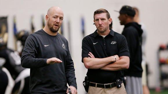 Justin Lovett, left, director of football strength