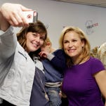 Latricia Tennapel of Waupun, left, takes a selfie of herself with Heidi Cruz, wife of presidential candidate Ted Cruz at a campaign stop Wednesday March 30, 2016 in Sheboygan Falls.