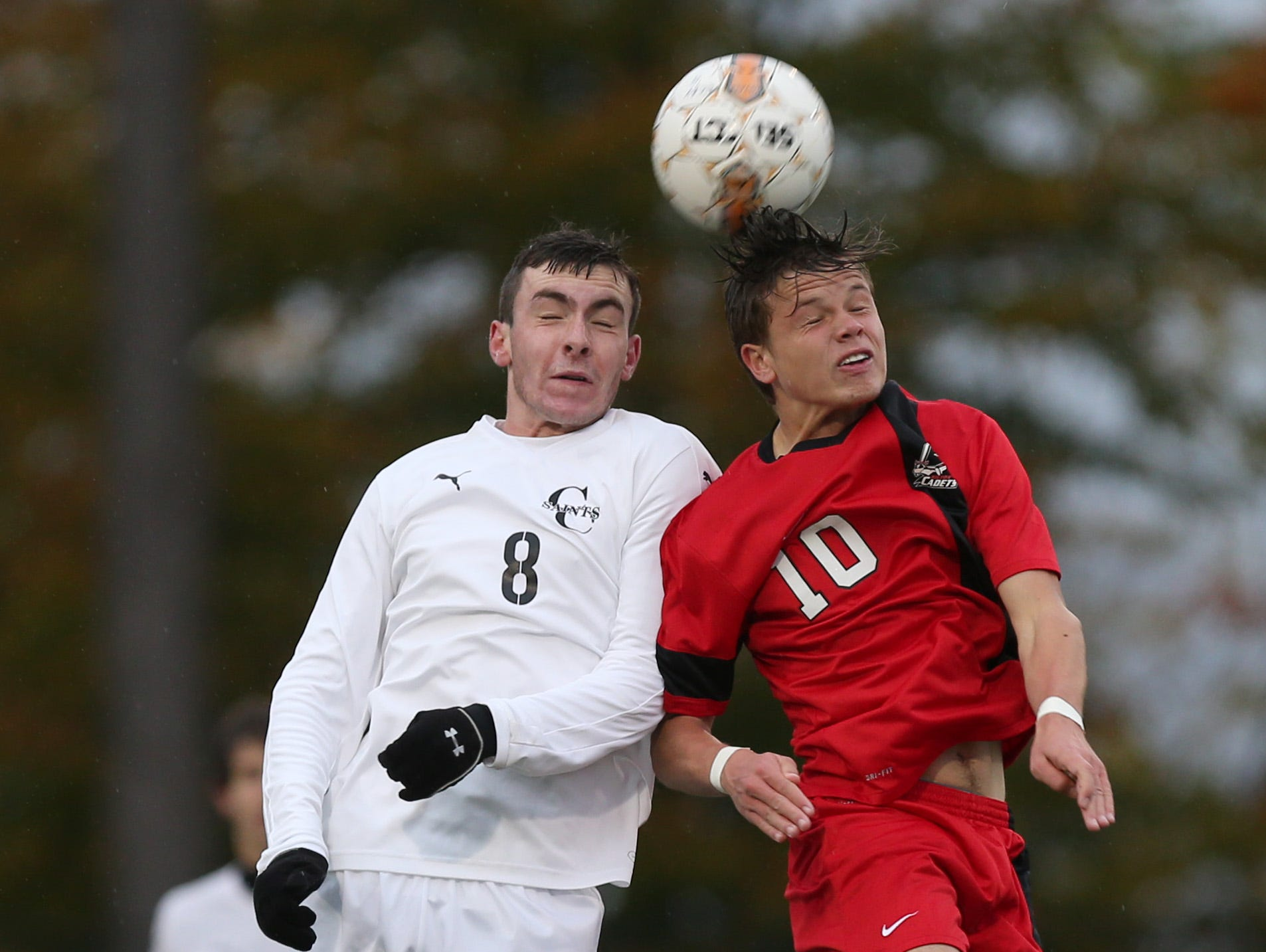 Churchville Chili's Austin Butts, left, and Hilton's Simon Garno battle for a header during their Class AA semifinal game at Spencerport Thursday, Oct. 29, 2015.