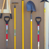 Before you hang up your garden tools for the season, clean them.