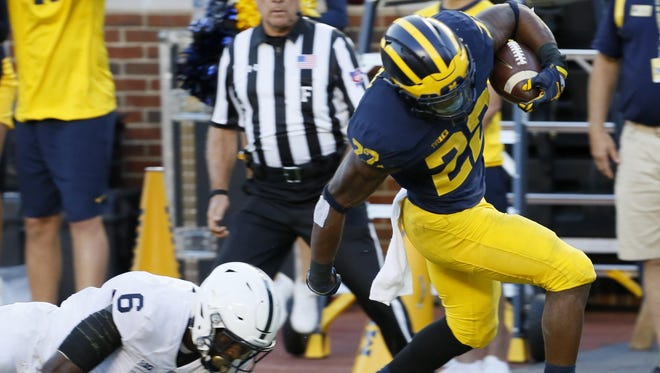 Michigan tailback Karan Higdon runs in for a touchdown during the Wolverines' 49-10 win over Penn State on Saturday, Sept. 24.