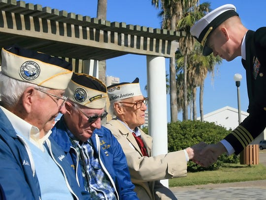 Pearl Harbor Survivors A.J. Dunn (from left), W.W. Loyd and Richard Byram are thanked for their service to the country by Capt. Randolph F. Pierson, the commanding officer of Naval Air Station Corpus Christi, after speaking at the Pearl Harbor Commemorative Ceremony in 2008  at Sherrill Park in downtown Corpus Christi.