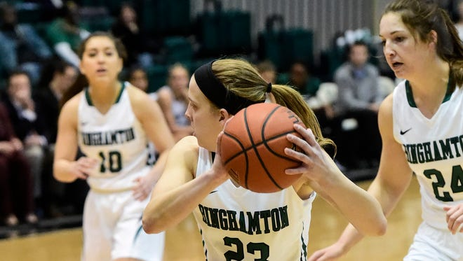 Binghamton University guard Kim Albrecht survey's the court during a game against the University of Vermont in the Event Center in January 2015.