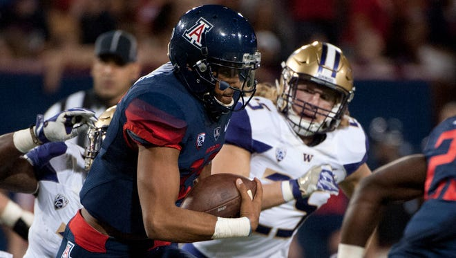 Sep 24, 2016; Tucson, AZ, USA; Wildcats quarterback Brandon Dawkins (13) runs the ball for a touchdown against the Huskies during the second quarter at Arizona Stadium.