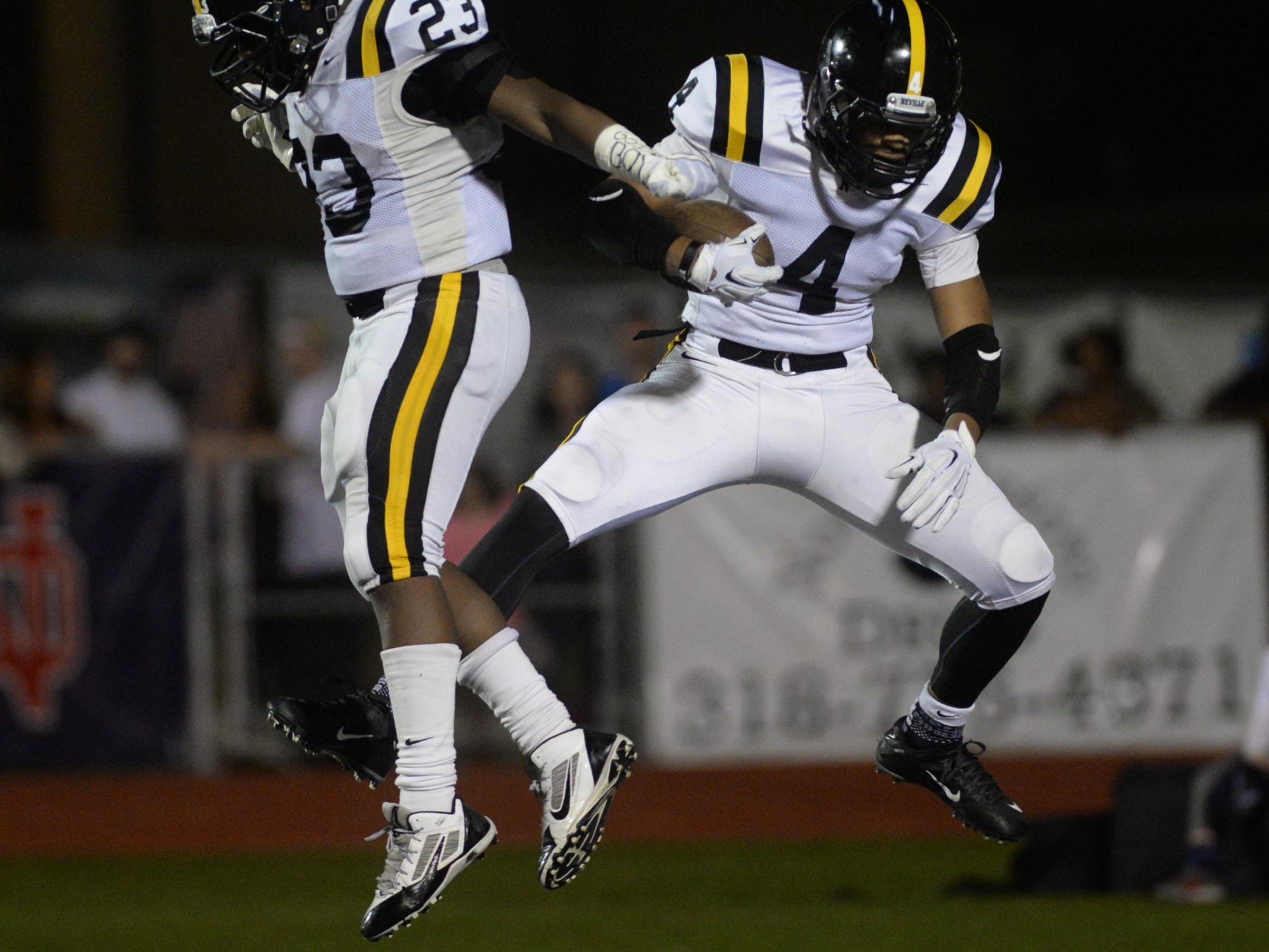 William Wooten (left) and Donald Jenkins celebrate Jenkins second quarter touchdown against North DeSoto.