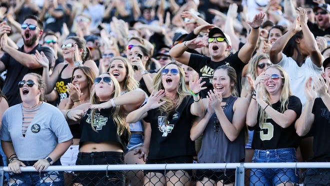 Dec 2, 2017; Orlando, FL, USA; UCF Knights fans celebrate after the Memphis Tigers missed a field goal at Spectrum Stadium. Mandatory Credit: Matt Stamey-USA TODAY Sports