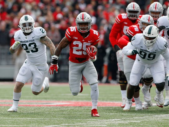 Ohio State Buckeyes running back Mike Weber (25) breaks free on a first quarter touchdown run against the Michigan State Spartans at Ohio Stadium.