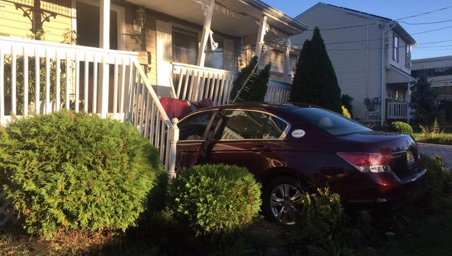 A car crashed into a home in Neptune.