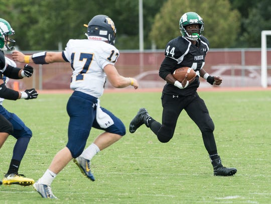 Parkside's Nayel Oge (44) carries the ball during a