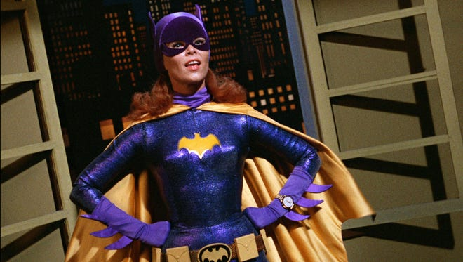 """In this image released by Warner Bros. Entertainment, Yvonne Craig portrays the crime-fighting Batgirl in the 1960s TV hit """"Batman."""" Craig died Monday, Aug. 17, 2015 in her Los Angeles home from complications from breast cancer. She was 78. (Warner Bros. Entertainment Inc via AP)"""