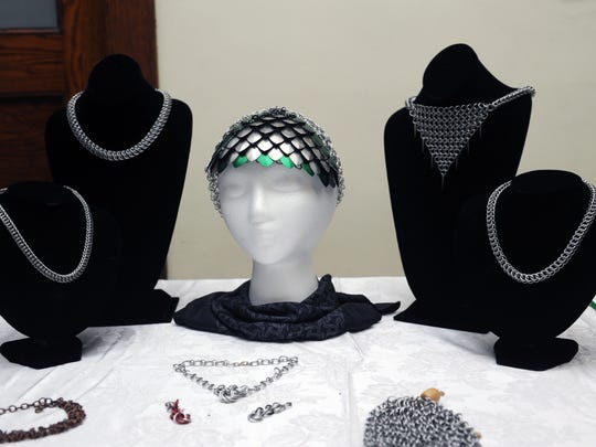 Custom scale and chain mail jewelry made by Alex King is displayed Jan. 2 during the First Friday Art Walk at the Masonic Temple in Zanesville. Eighteen studios and galleries and 14 businesses participated in the event.