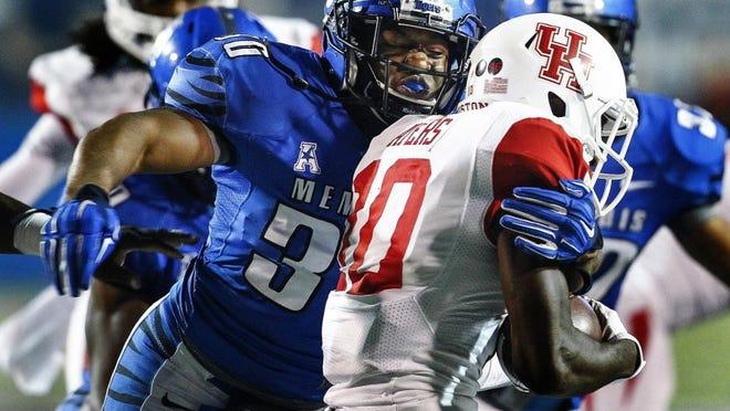 Memphis' Shareef White (left) brings down Houston's Demarcus Ayers.