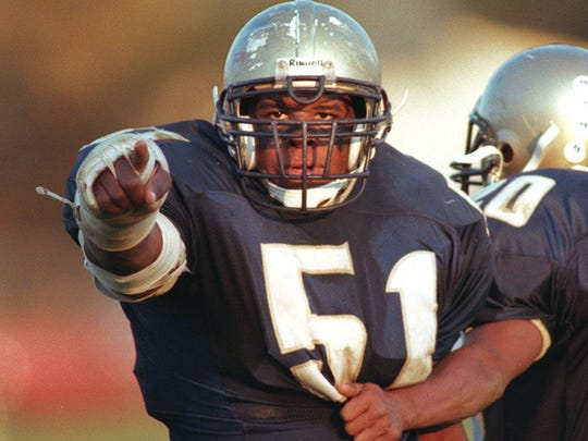 Freehold linebacker Darrell Reid showing some emotion during a 1999 game.