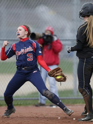 Appleton East High School's Megan Schweitzer (3) pumps her fist after forcing out Oshkosh North High School's Lauren Christie (18) during their softball game Tuesday, April 19, 2016, in Appleton.