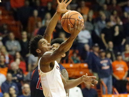 UTEP guard Omega Harris drives to the basket against