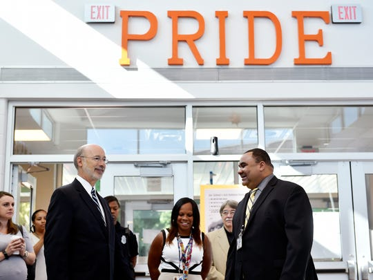 Gov. Tom Wolf speaks with Ferguson K-8 principal Melanie Still and York City School District Supt. Eric Holmes in the school lobby Wednesday. Holmes told Wolf about district initiatives including Ferguson's STEAM (science, technology, engineering, art and math) program.