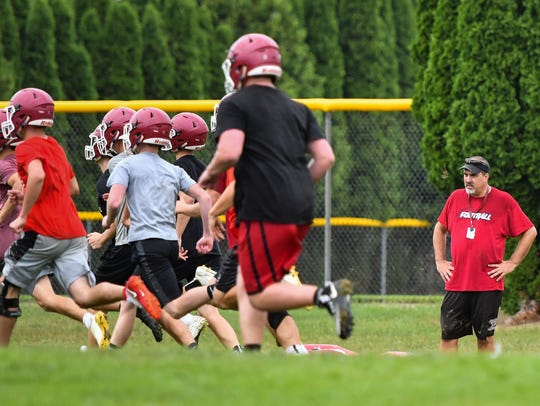 Headed into his 20th season, Portland head football coach John Novara, right, works his Raiders Monday morning, Aug. 6, 2018, during the first practice at the high school.
