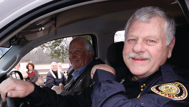 Fairview Police Chief Terry Harris with then City Manager Wayne Hall in 2014 Fairview Christmas Parade.