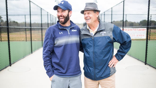 Father and son tennis coaching duo Billy Boykin and Jim Boykin stand for a portrait before a match between Queens University and Anderson University on Saturday, March 25, 2017 in Anderson.