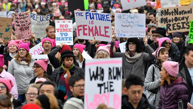 1/21/17 9:55:53 AM -- Washington, DC, U.S.A: People walk to the rallying point for the start of the Women's March on Washington in Washington, D. C. on January 21, 2017, one day after the inauguration of President-elect Donald J. Trump.  Photo by Robert Hanashiro, USA TODAY Staff